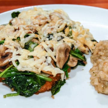Smothered chicken breasts with asiago mushrooms and spinach