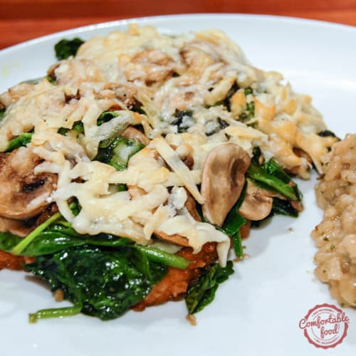 Chicken breasts smothered with Asiago cheese, spinach and mushrooms.