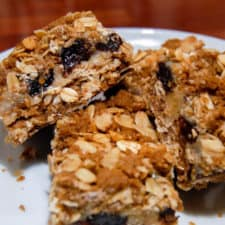 3 squares of recipe for triple good bars on white plate