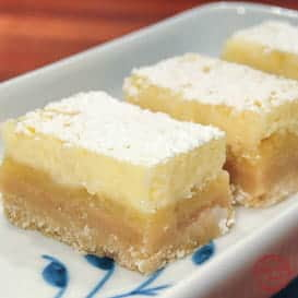 Zesty Lemon Bars with Cheesecake Topping 4
