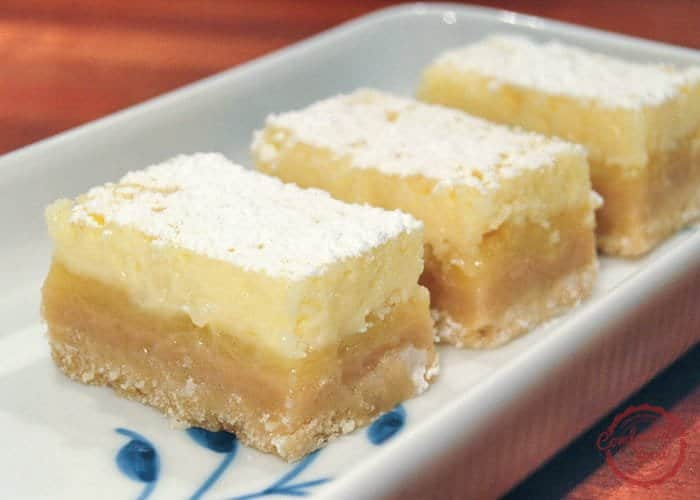 comfortable food - zesty lemon bars with cheesecake topping