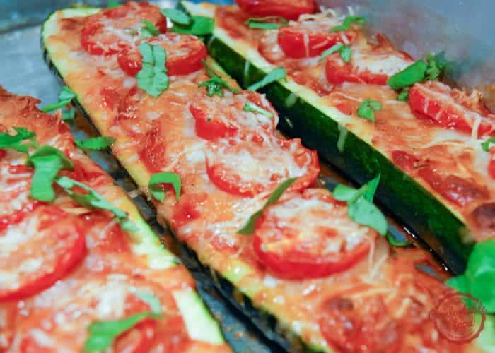 Super easy, low carb zucchini pizza boat recipe.