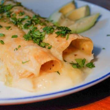 Rich and creamy chicken enchilada recipe.