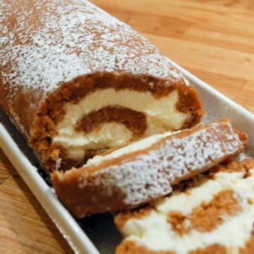 Spiced pumpkin roll cake with cream cheese filling