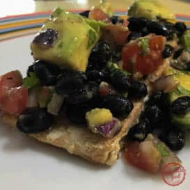 Light and healthy grilled salmon recipe with avocado black bean salsa.
