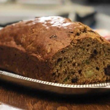 Freshly baked chocolate chunk zucchini banana bread loaf